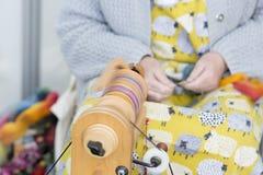 Woman handspinning wool Stock Image