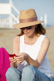 Woman with handy on the seaside Royalty Free Stock Photos