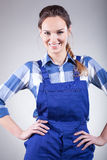 Woman in handyman dress Royalty Free Stock Photos