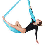 Woman hanging in aerial silk Stock Images