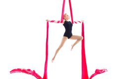 Woman hanging in aerial silks, isolated on white Stock Photo