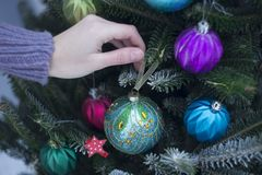 Woman decorating an outside Christmas tree stock images