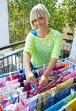 Woman hanging clothes Stock Photos