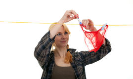 Woman hanging clothes on clothesline Royalty Free Stock Photos