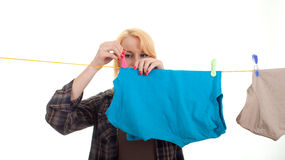 Woman hanging clothes on clothesline Stock Image