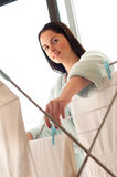 Woman hanging freshly washed clothes Royalty Free Stock Photography