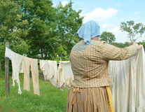 Woman Hanging Laundry Stock Photo