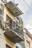 Woman hanging laundry from balcony Havana Royalty Free Stock Photos