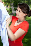 Woman hanging the laundry Stock Photo