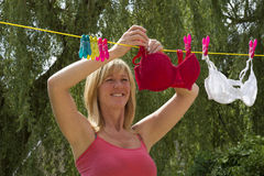 Woman hanging out her washing Royalty Free Stock Images