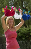 Woman hanging out her washing Royalty Free Stock Photography