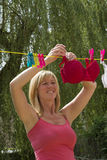 Woman hanging out her washing Royalty Free Stock Photos