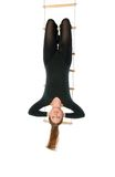 Woman hanging on a rope ladder royalty free stock images