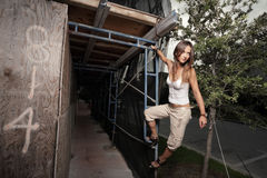 Woman hanging from scaffolding Stock Images