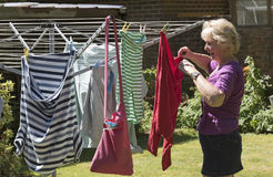 Woman hanging washing out to dry Stock Photos