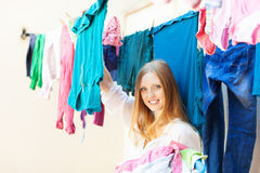 Woman hangs clothes to dry Royalty Free Stock Photo