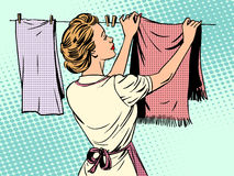Woman hangs clothes after washing housewife Stock Photo