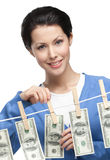 Woman hangs money on the line Royalty Free Stock Images