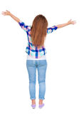 Woman happily greets someone. girl waving. Royalty Free Stock Photo