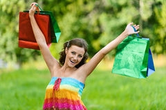 Woman happily holds up Stock Images