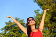 Woman happiness in nature summer. Blissful woman raising arms to the sky in forest surrounded by trees. Carefree, happiness, hope and vitality concept. Caucasian Royalty Free Stock Image