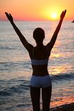 Woman is happy on the beach. Royalty Free Stock Photos