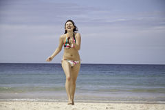 Woman happy on a beach Stock Images