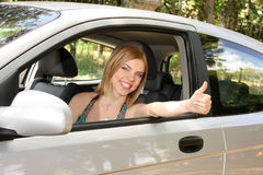 Woman happy in car Stock Photo