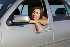 Woman happy in car Royalty Free Stock Images