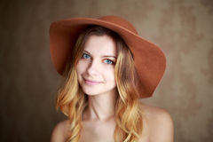 Woman happy and carefree in the hat. Stock Photos