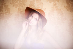 Woman happy and carefree in the hat. Royalty Free Stock Image