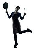Woman happy cooking holding frying pan silhouette Royalty Free Stock Photos