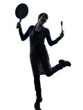 Woman happy cooking holding frying pan silhouette Stock Photography