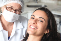 Woman happy with dentist Royalty Free Stock Photography