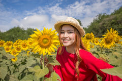 Woman happy and enjoy in sunflower field Royalty Free Stock Photos