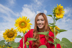 Woman happy and enjoy in sunflower field Royalty Free Stock Image