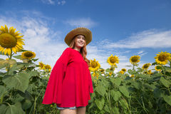 Woman happy and enjoy in sunflower field Stock Photo