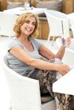 Woman with happy expresion holding glass of water at restaurant Royalty Free Stock Images