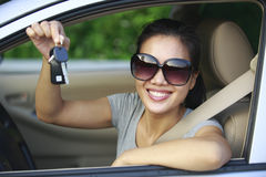 Woman happy with first car. Woman driver with her first car Stock Image