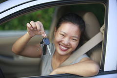 Woman happy with first car Stock Photo