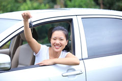 Woman happy with first car. Happy woman driver with her first car Royalty Free Stock Image