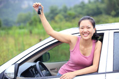 Woman happy with first car. Happy woman driver with her first car Stock Image