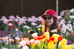 Woman happy flowers garden Royalty Free Stock Image