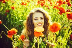 Woman or happy girl in field of poppy seed royalty free stock images