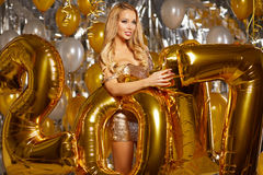 WOman and Happy 2017 gold New Year Balloons.  Stock Photos