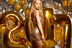 WOman and Happy 2017 gold New Year Balloons Royalty Free Stock Photos