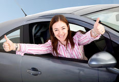Woman happy with her new car Stock Photos