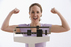 Woman Happy with Her Scale Results - Isolated Royalty Free Stock Photos
