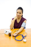 Woman happy with her self blood pressure test Stock Photo
