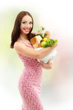 Woman happy holding food bag Stock Photography